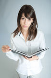 Aerial view of brunette in white shirt with book Stock Image
