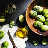 Aerial view of Brussels sprouts with knife and cooking oil Stock Images