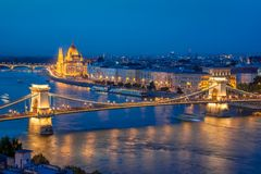 Aerial view of Budapest parliament and Chain bridge over Danube river at night Hungary. Aerial view of Budapest parliament and Chain bridge over Danube river at royalty free stock photo