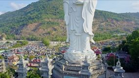 Aerial View of Buddha Statue Pedestal and Four Towers stock video