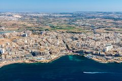 Aerial view of Bugibba town, St. Paul's Bay in the Northern Region, Malta. Popular tourist resort destination with promenade. Aerial view of Bugibba Buġ stock image