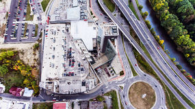Aerial view, building, car park and highway passing through town Royalty Free Stock Photos