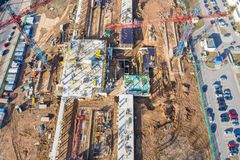 Aerial view of building construction site with tower cranes stock photos