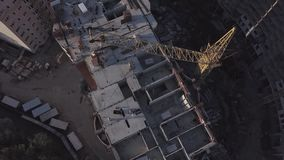 Aerial view of building cranes and buildings under construction. Fight over the construction site stock video footage