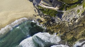 Aerial view of building at edge of beach rock ledge royalty free stock photo