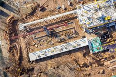 Aerial view of building under construction with tower crane stock photography