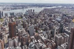 Cityscape and East River of Manhattan in New York City, USA. Aerial view of buildings and the East River of Middle Manhattan in New York City, USA stock photography