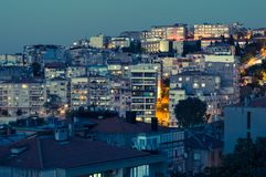 Aerial view of buildings in Konak district of Izmir city at night. Izmir is the third most populous city in Turkey Stock Image