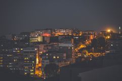 Aerial view of buildings in Konak district of Izmir city at night. Izmir is the third most populous city in Turkey Royalty Free Stock Images