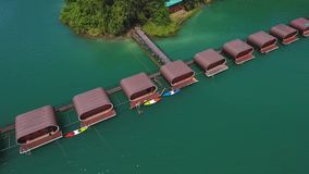 Aerial View on Bungalows at Cheow Lan Lake, Khao Sok National Park in southern Thailand. HD Slowmotion. stock video