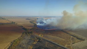 Aerial view of burning field stock footage