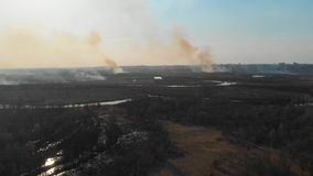 Aerial view of the burning fields near the city. Burning fields in the spring near the city. stock footage
