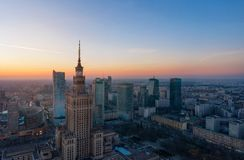 Aerial view of the business center of Warsaw: Palace of Science and Culture and skyscrapers in the evening. Aerial view of Warsaw business center: Palace of stock photos