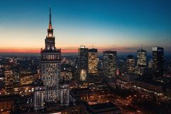 Aerial view of the business center of Warsaw: Palace of Science and Culture and skyscrapers in the evening. Aerial view of Warsaw business center: Palace of royalty free stock images