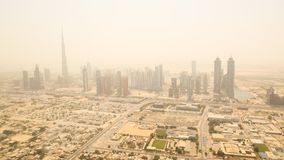 Aerial view of the business district of Dubai. Shooting in the summer haze of heat. August 2014. UAE. Royalty Free Stock Photos