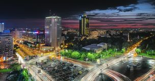 Aerial view of the business district in the Victoria Square. Night lights after a storm, sunset in Bucharest, Romania royalty free stock photos