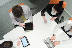 Aerial view of business people group brainstorming on meeting Stock Photos