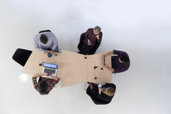 Aerial view of business people group on meeting. Top view of multi ethnic startup business people group on brainstorming meeting in modern bright office interior Stock Photography