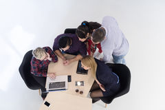 Aerial view of business people group on meeting. Top view of multi ethnic startup business people group on brainstorming meeting in modern bright office interior Royalty Free Stock Photo