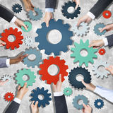Aerial View of Business People Holding Gear Symbols Royalty Free Stock Image