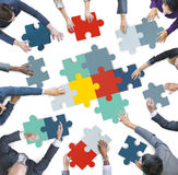 Aerial View of Business People Piecing Puzzle Pieces Stock Images