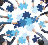 Aerial View of Business People Piecing Puzzle Pieces Stock Photography