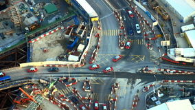 Aerial view of busy crossroad with moving cars in construction area. Hong Kong stock footage