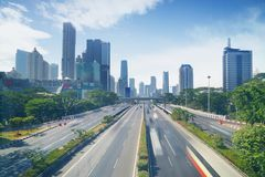 Busy highway in the Jakarta downtown. Aerial view of busy highway with office building in the Jakarta downtown, Indonesia Stock Images