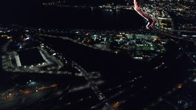 Aerial of Lights and Traffic in Oakland, California at Night. An aerial view of the busy highways in Oakland, CA. The city is known for its sustainability stock video footage