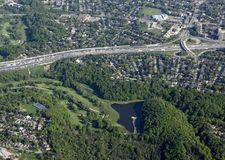 Urban golfcourse and highway aerial. Aerial view of a busy multi lane highway near a golf course and residential area, Toronto Ontario Canada stock photos