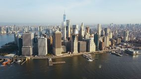 Aerial view of busy New York city in America, Manhattan district on the shore of East river. Drone flies to city centre. stock video footage
