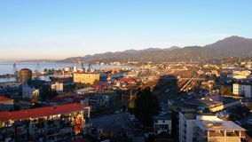 Aerial view from the cable car on Batumi, seaport, houses, streets and mountains in the background.  stock video footage