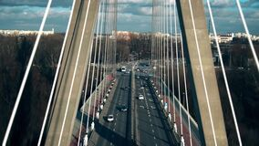 Aerial view of cable-stayed bridge traffic in Warsaw, Poland stock video footage
