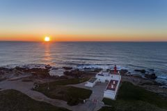 Aerial view of the Cabo Raso lighthouse near Cascais at sunset royalty free stock photo