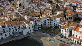 Aerial view of Cadaques Spain. cozy beautiful houses streets and tiled roofs. drone video footage of the camera. Cadaques Spain. cozy beautiful houses streets stock video footage