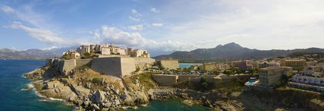 Aerial view of Calvi city, Corsica, France. Walls of the city, cliff overlooking the sea Royalty Free Stock Photography