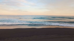 Aerial view. Camera twirled sea. Sun at sunset shining into the camera.  stock footage