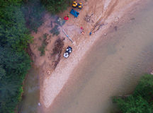 Aerial view. Camp ATV drivers in the forest by the river. Stock Images