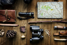 Aerial view of camping equipments and map on wooden table Royalty Free Stock Photo
