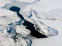 Aerial view of the Canadian dark lake. Aerial view of the Canadian lake, surrounded by rocks and snow stock photography