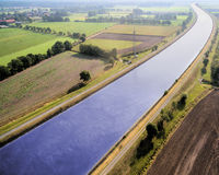 Aerial view of a canal diagonal through the image royalty free stock image