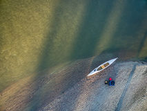 Aerial view of canoe on river shore Stock Images