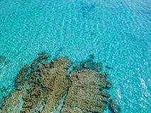 Aerial view of a canoe in the water floating on a transparent sea. Bathers at sea. Stock Photos