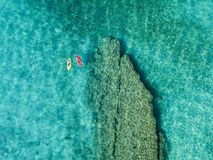 Aerial view of a canoe in the water floating on a transparent sea. Bathers at sea. Zambrone, Calabria, Italy. Diving relaxation and summer vacations. Italian stock photos