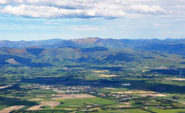 Aerial View of The Canterbury Plains & Port Hills. An aerial view of the Canterbury Plains, farms and the southern suburbs of Christchurch, New Zealand. In the Stock Image