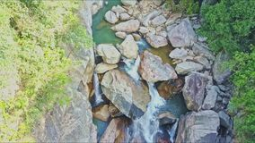 Aerial view of canyon with river running among stones. Aerial view of canyon with long clean blue river running among stones with green plant banks stock video footage