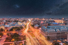 Aerial view of the capital city of Romania, Bucharest. Night sky with stars Stock Images
