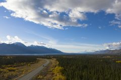 Alcan Highway. Aerial view of a car driving the Alaska Highway leading towards Kluane Lake in the Yukon in Canada on a sunny day during the Indian Summer stock images