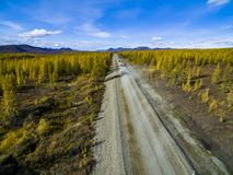 Aerial view of car driving through the forest on country road. Russia stock images