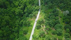 Aerial View of Car Driving in Lush Tropics. Shot with a Sony a6300 fps29,97 4k stock footage